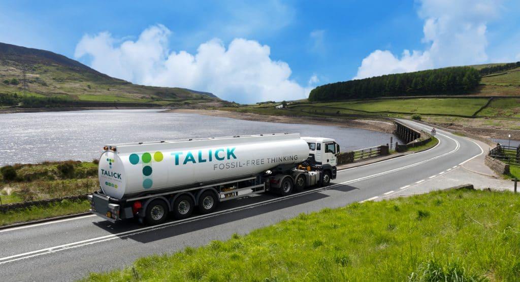 Talick lorry driving alongside a lake