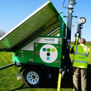 Talick engineer setting up solar panel lighting