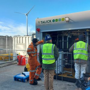 Three Talick engineers working on site