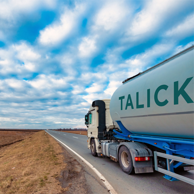 Talick tanker driving through fields